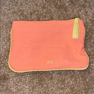 Small orange and yellow makeup bag
